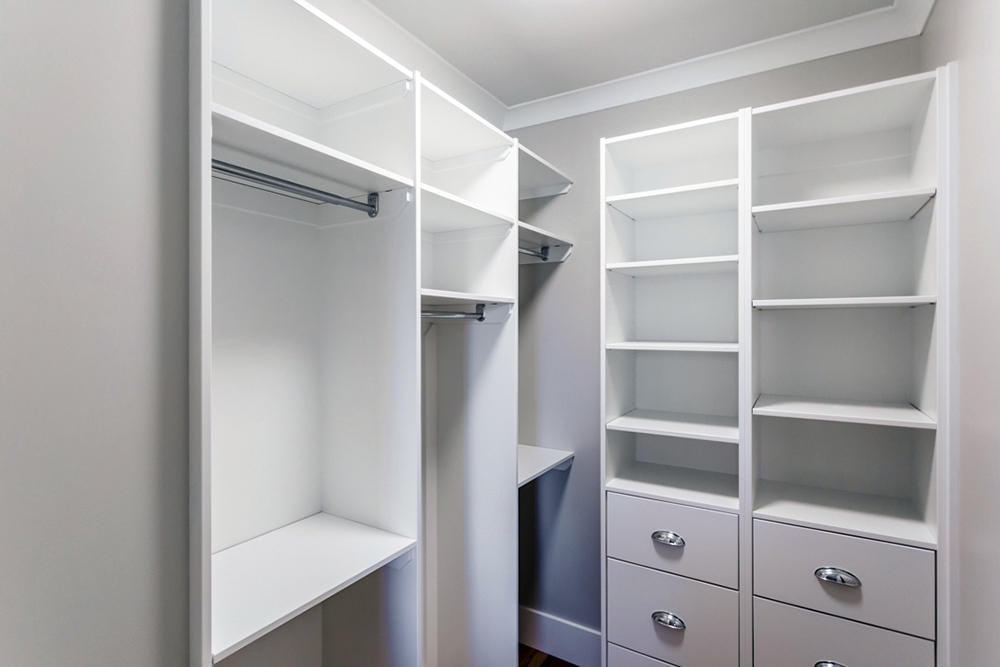 regina walk in closet with built-in shelves multi-level rods