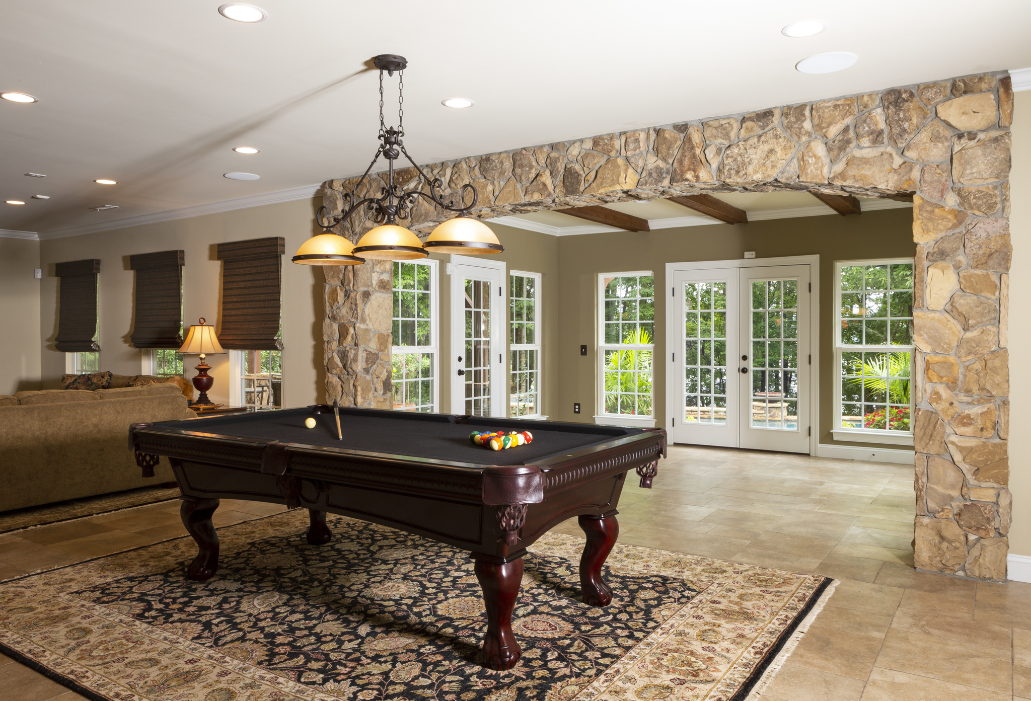 game room with pool table custom lighht fixture