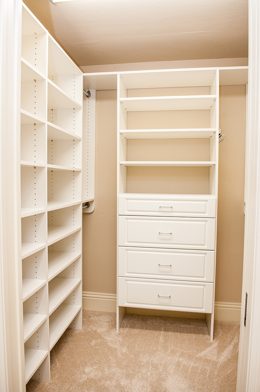 small closet with all white built in shelving