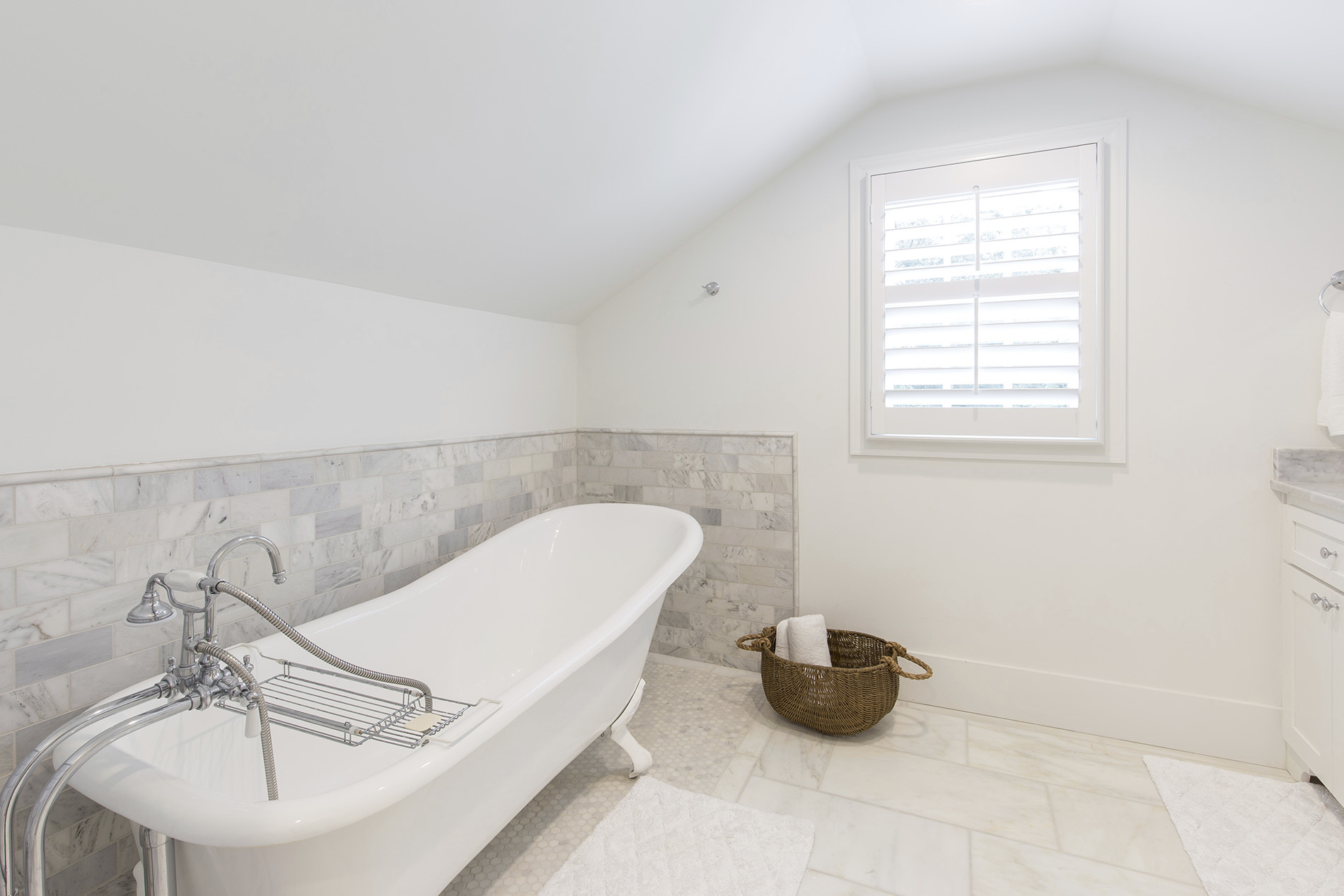 Custom all white bathroom with geometric tile detail
