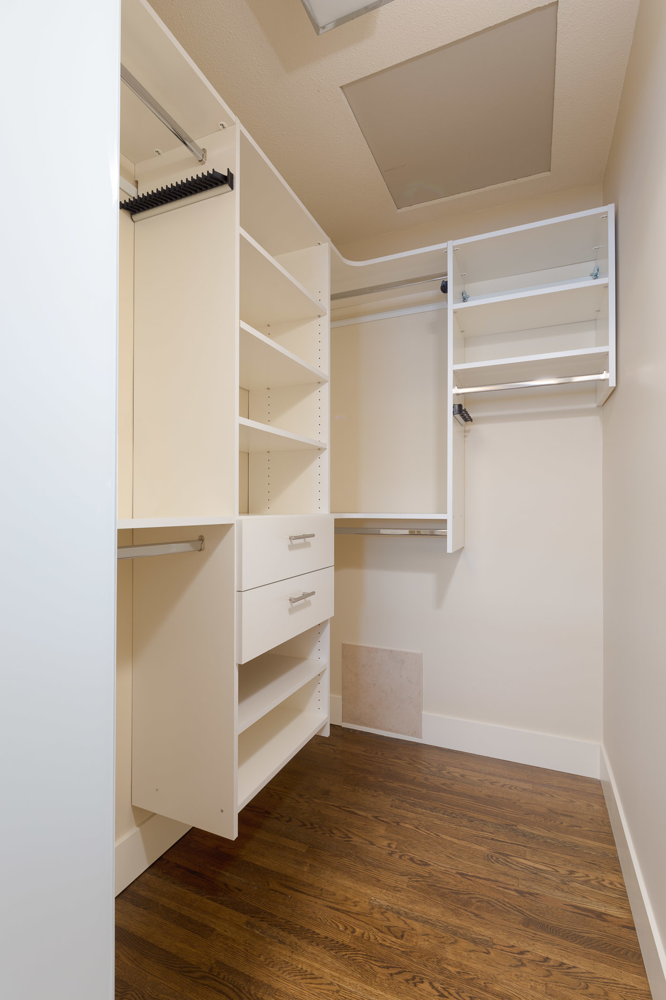 closet with built in shelves and organizing units