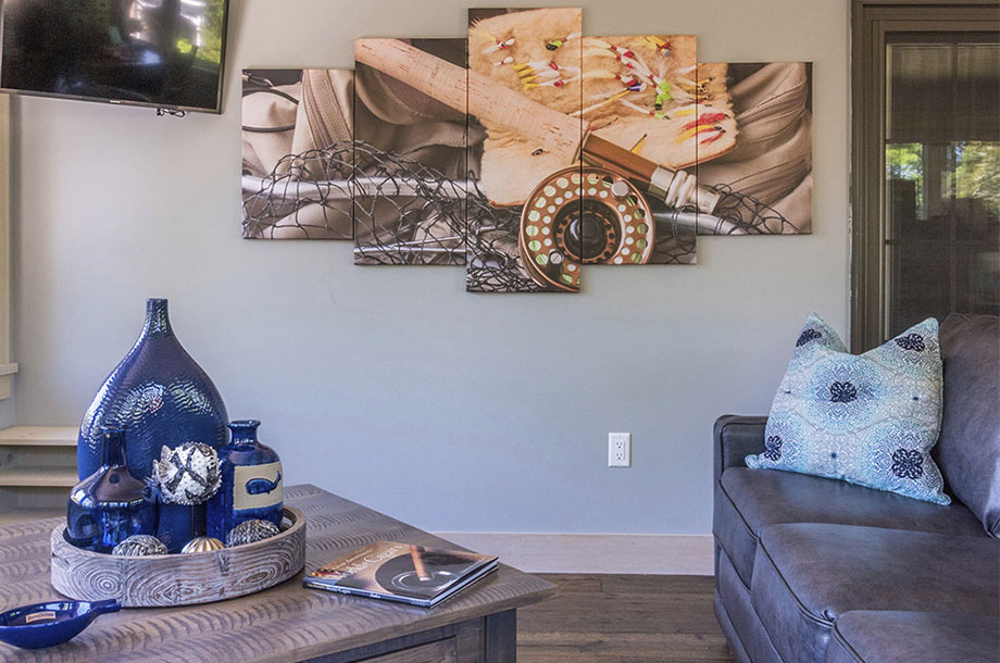 custom home filled with colorful decor and canvas art on wall