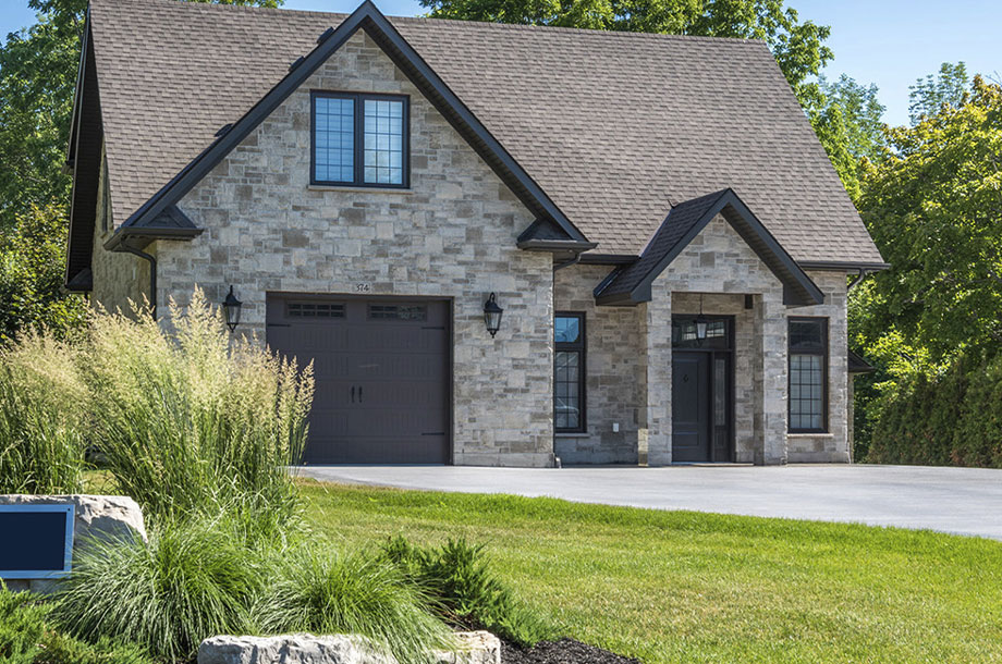 exterior of luxury custom home grey bruce with turfgrasss front lawn