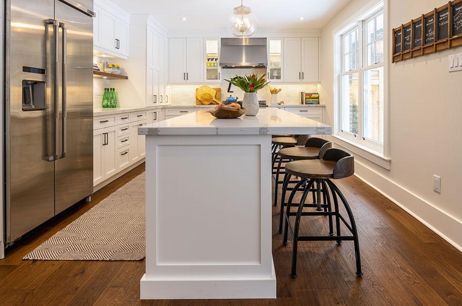 custom kitchen with large white island bright decor and dark vinyl flooring