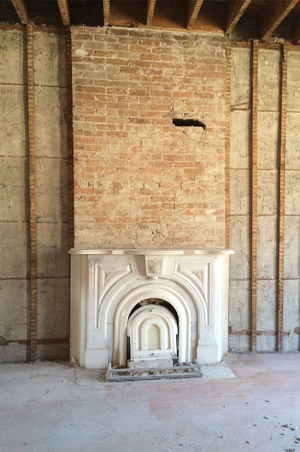 Salvaged marble and brick fireplace found in teardown renovation