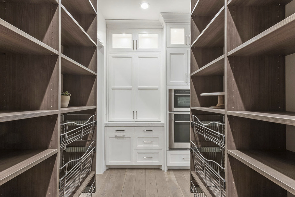 collingwood closet with built in shelving and wire baskets