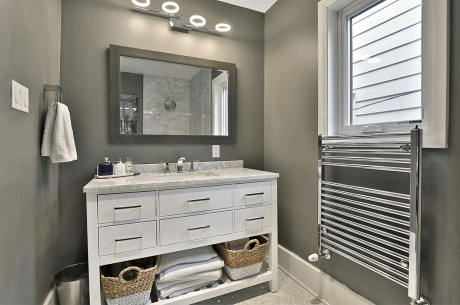 guest bathroom complete with space for extra towels and toiletries below sink