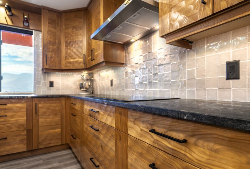 Wooden kitchen cabinets with black hardware