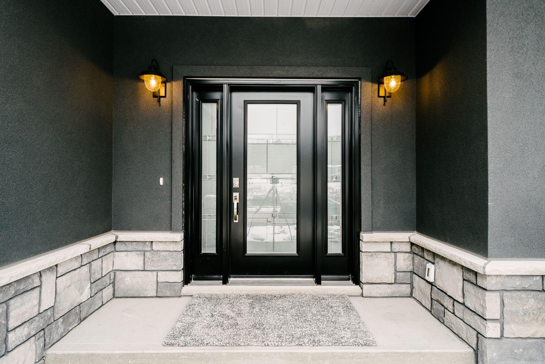 dark front door with modern sconces