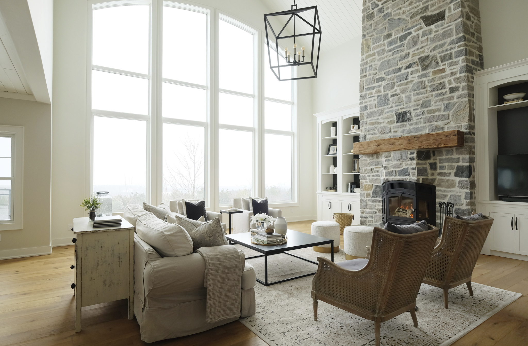 custom modern living room with sofa and seating around stone fireplace
