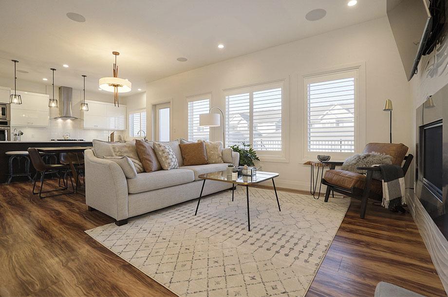 living area with dark wooden printed luxury vinyl flooring and cream sofa