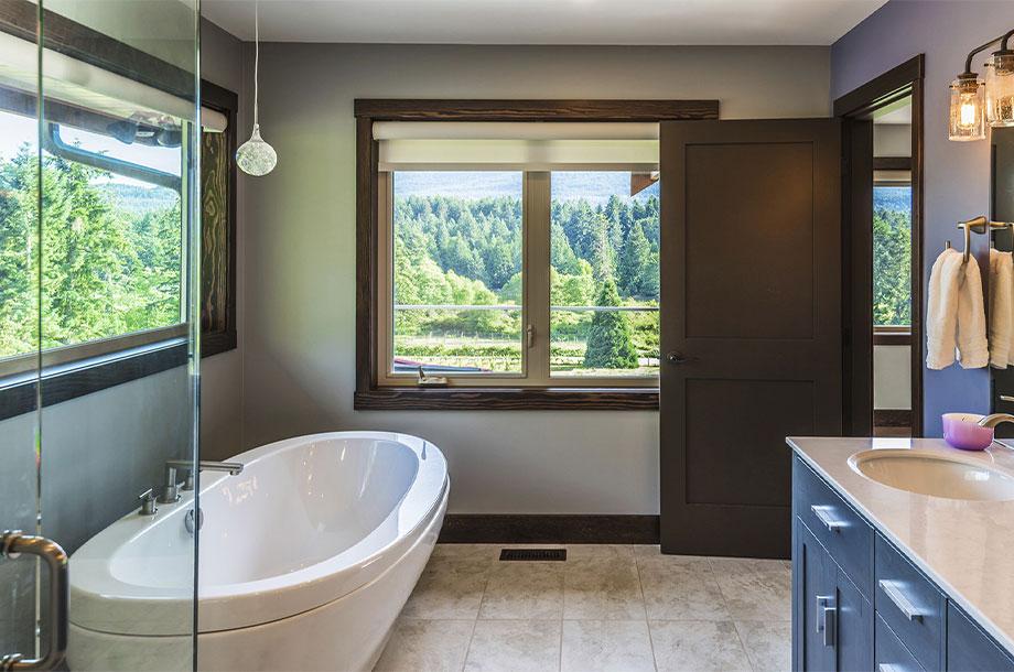 custom bathroom with destination tub and large windows