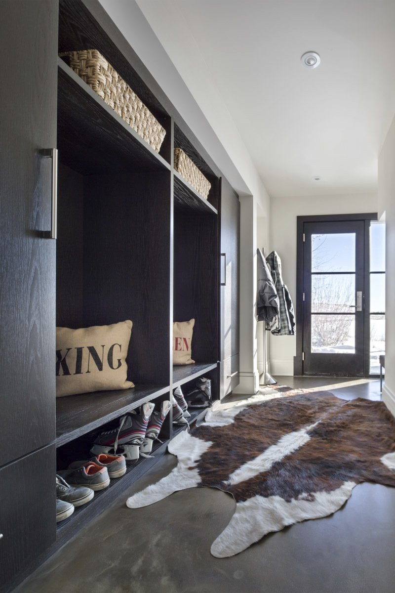 custom mudroom with statement animal rug and sliding cupboard doors