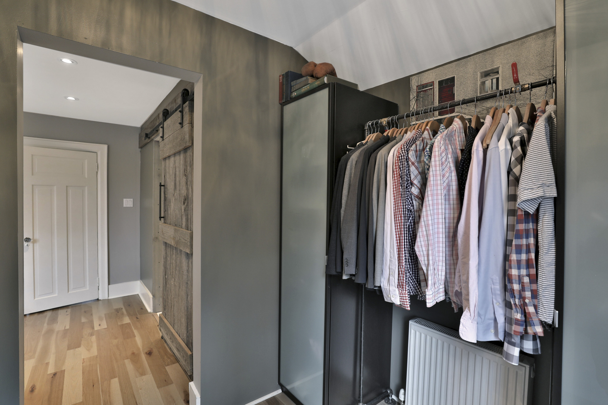 custom closet with tall black organizer and high rod with space for shoes below
