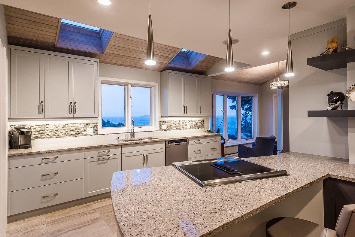 modern monochromatic cream kitchen with inset skylights
