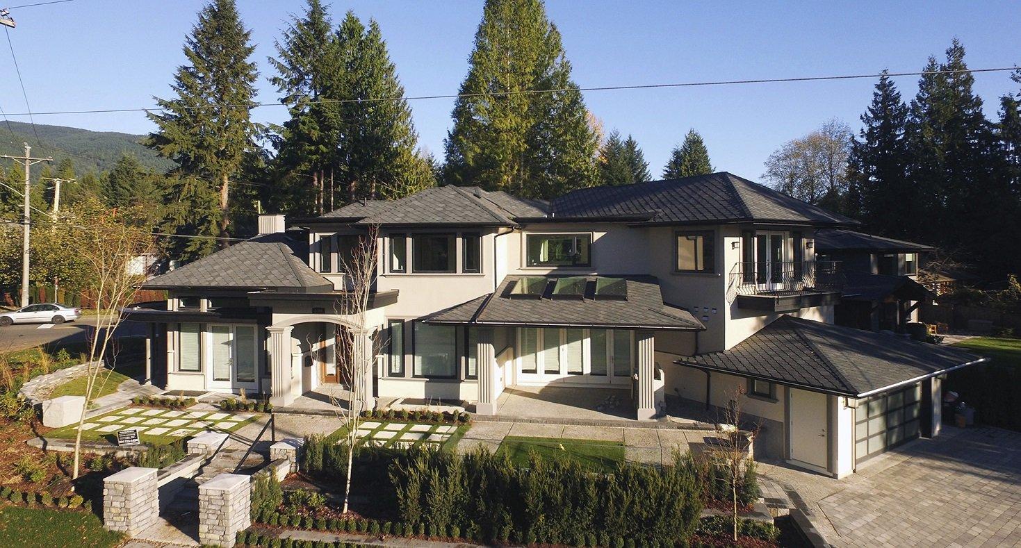 exterior large multi-story cream painted custom home