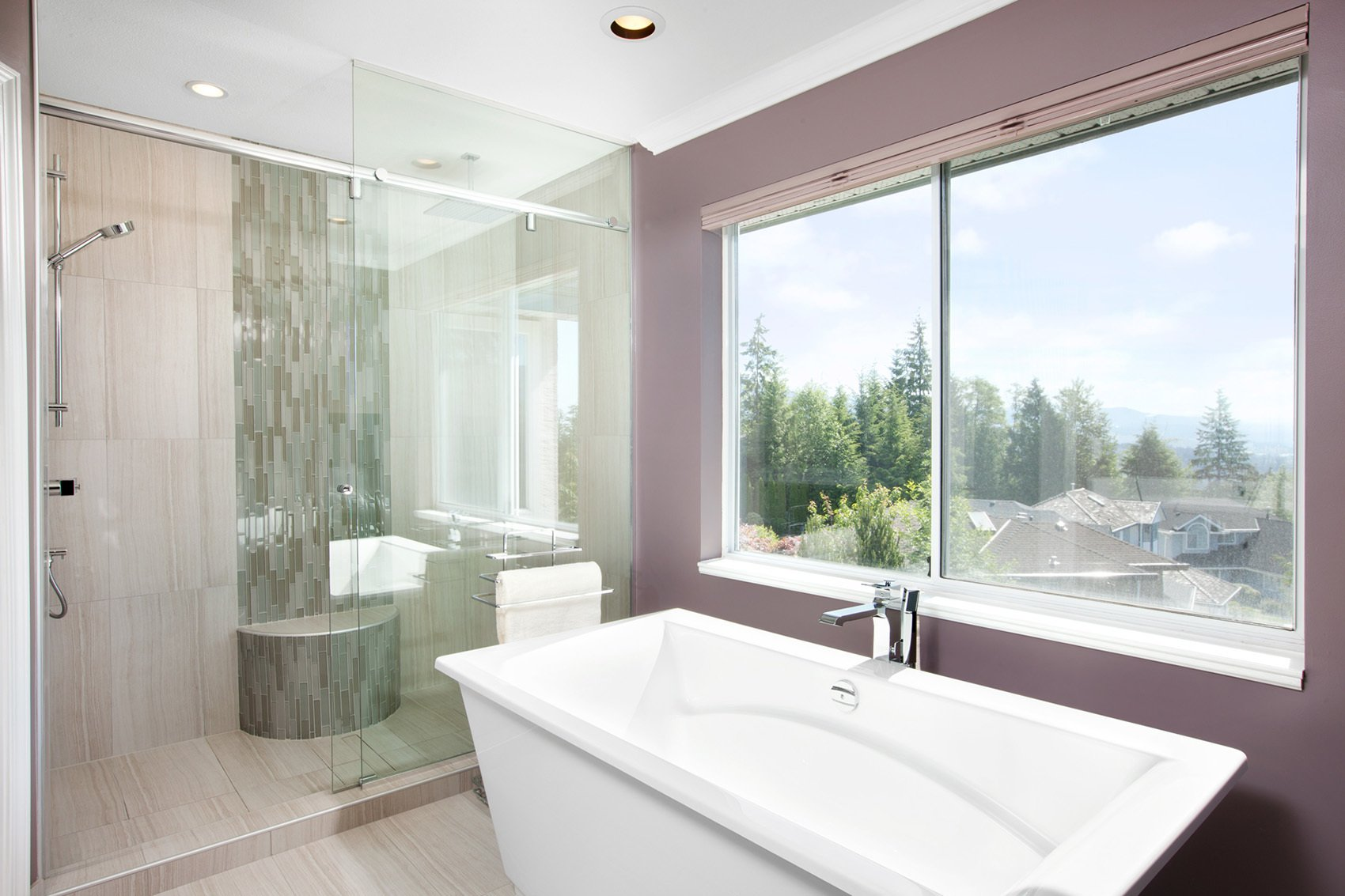 Destination bath tub in luxurious custom spa bathroom