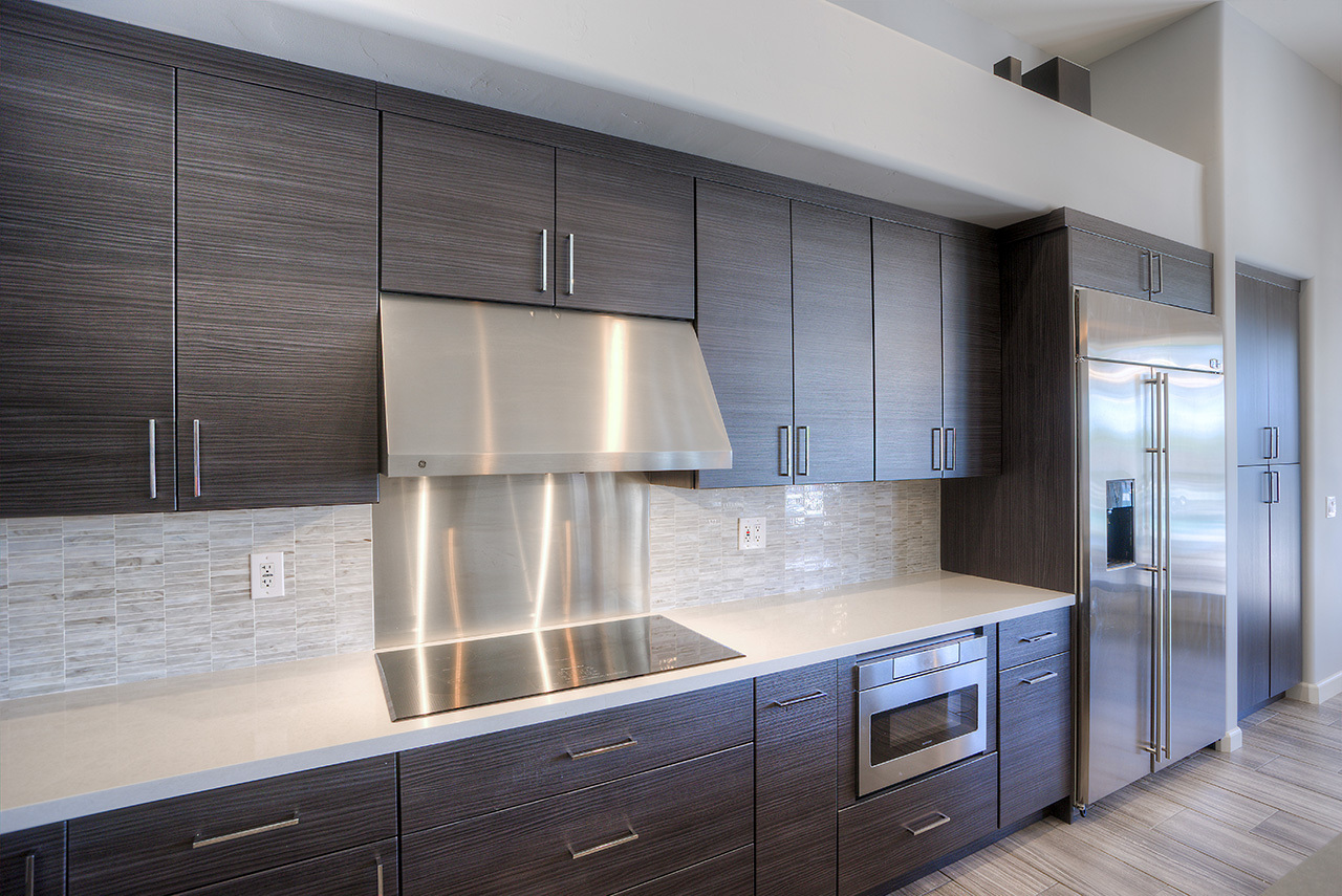 kitchen with dark wood cabinets and stainless steel finishing