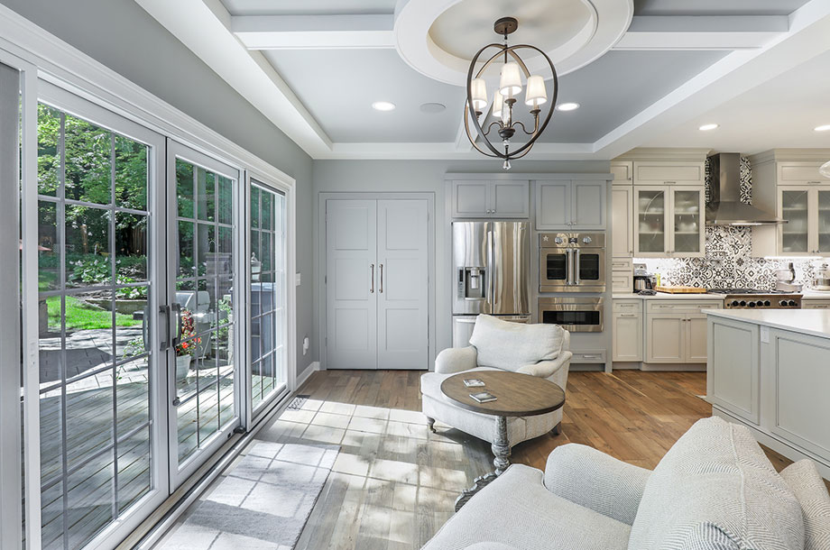 custom kitchen with sitting area facing outdoor garden letting in natural light