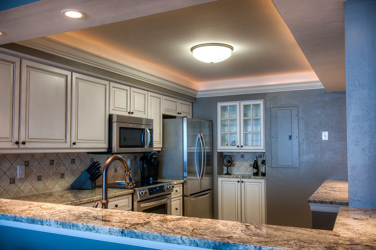 looking over bar to sanibel kitchen with inset ceiling light