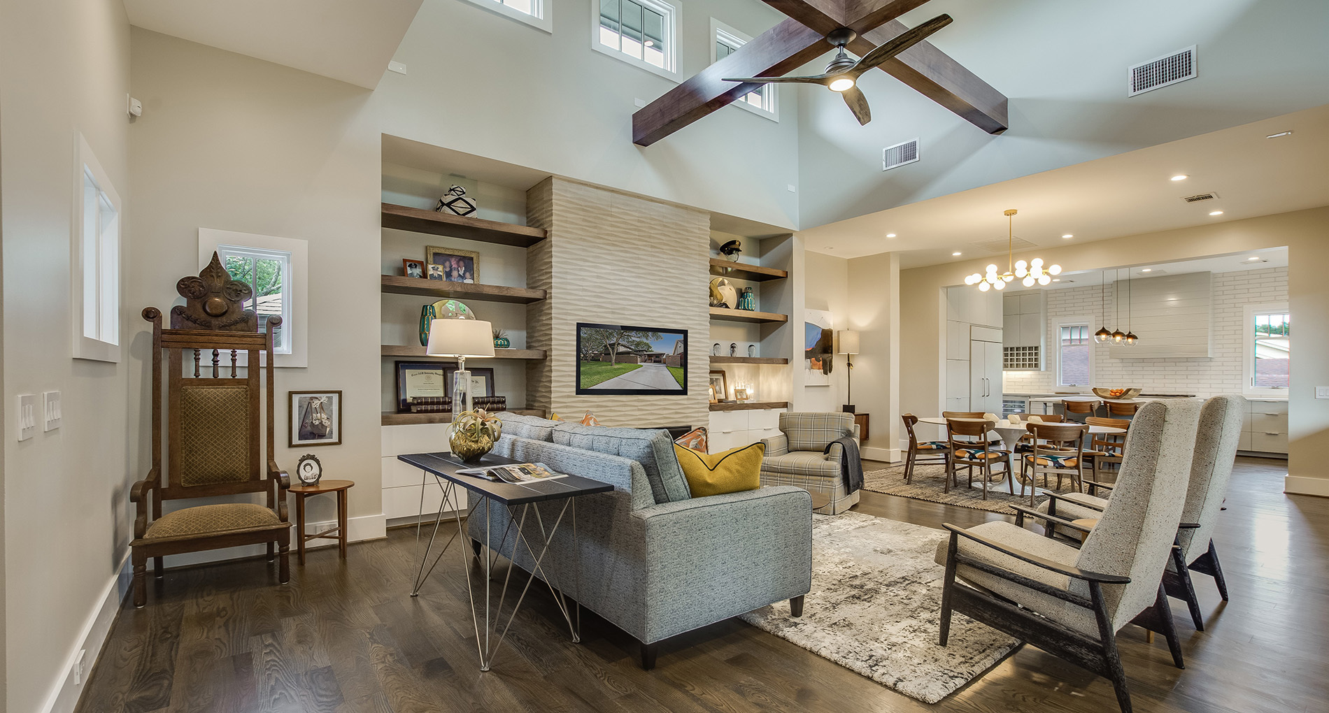 living room with built in shelving high ceilings cozy decor