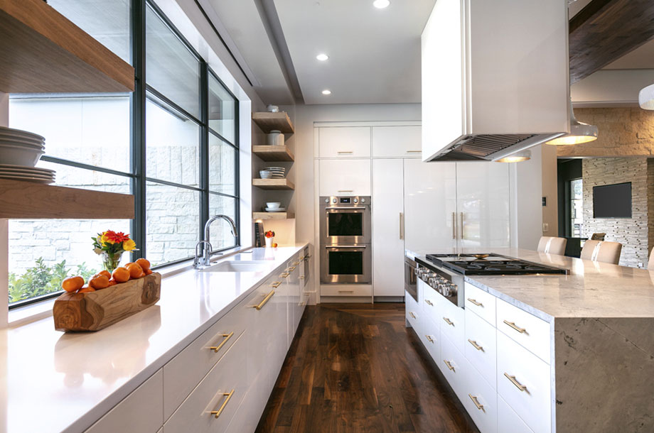 custom houston kitchen with natural lighting and fresh flowers on top of all white counter