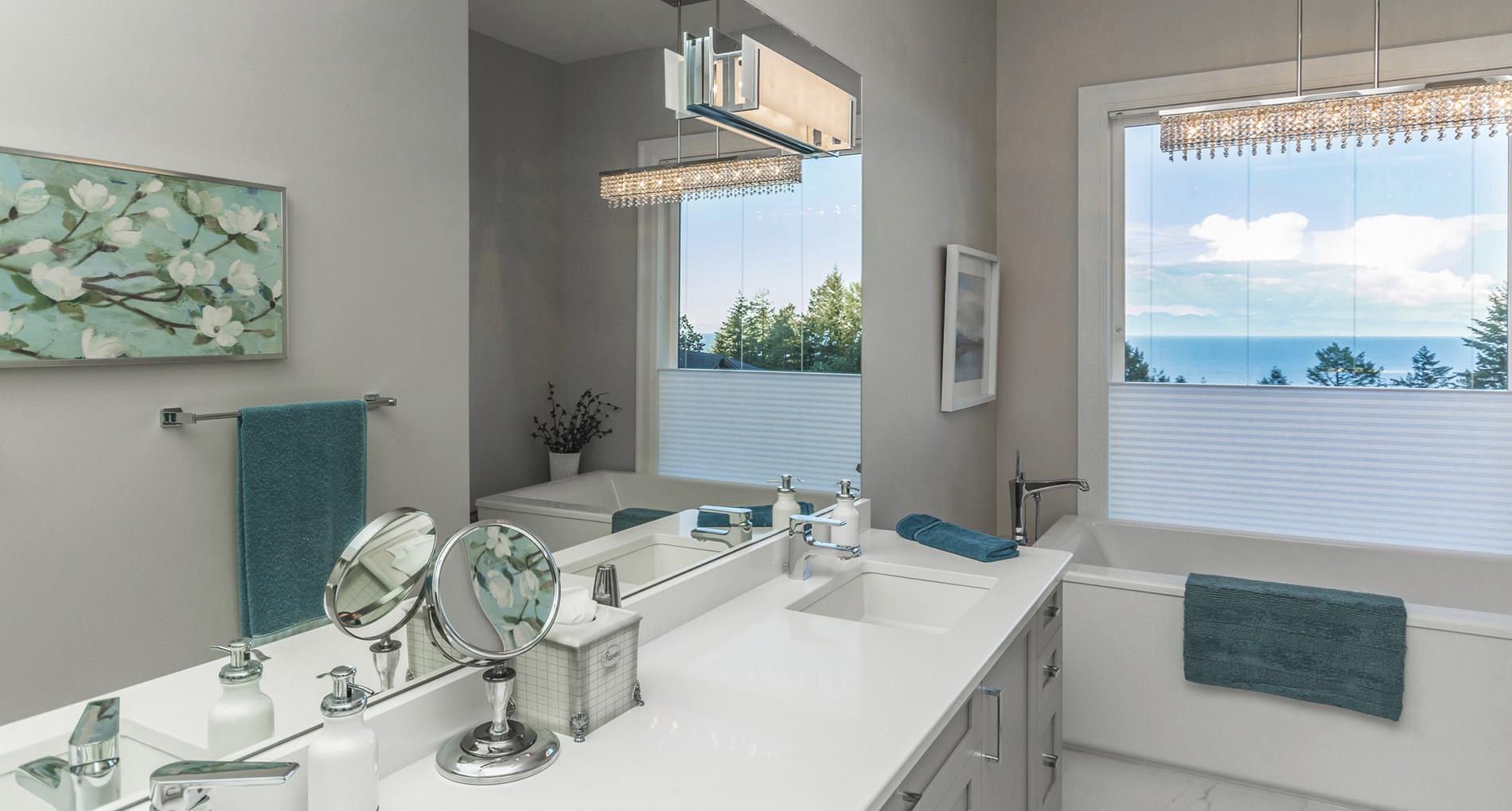 custom bathroom with large window beside private tub