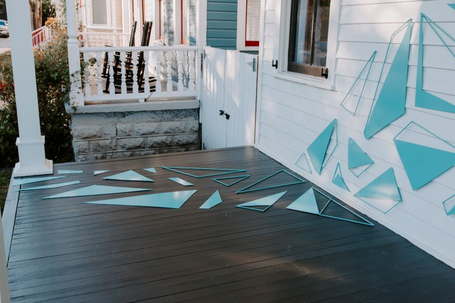 blue triangles on white porch art installation