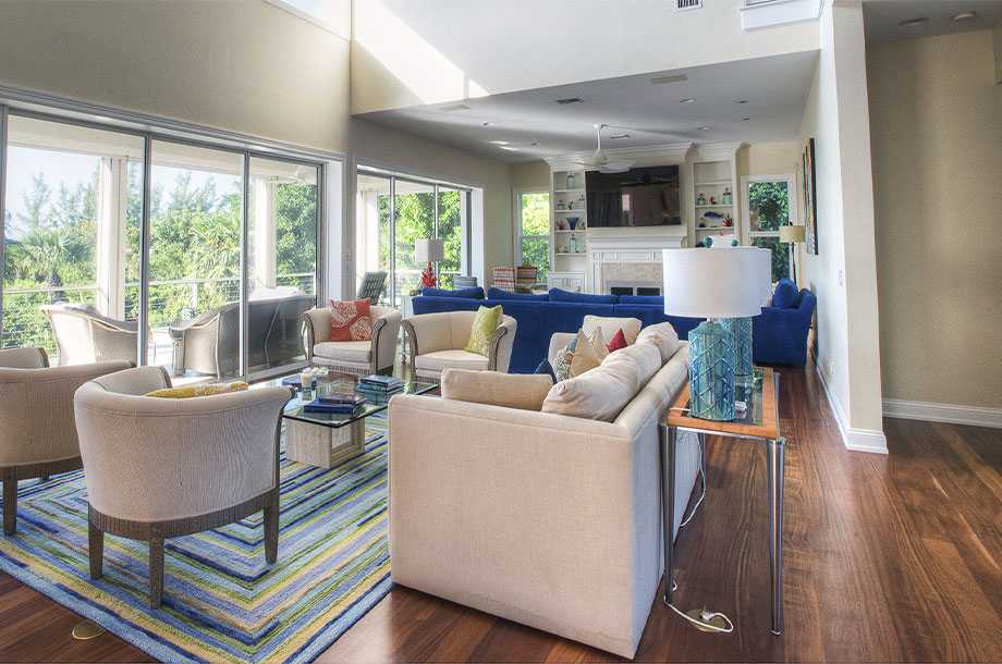 living space in open concept custom home with large windows and cream sofas