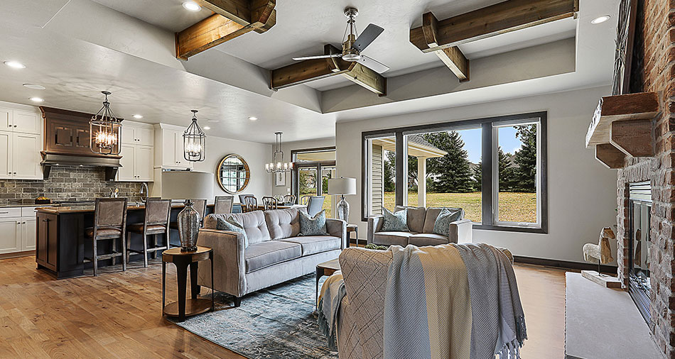 Living area with neutral decor and large windows