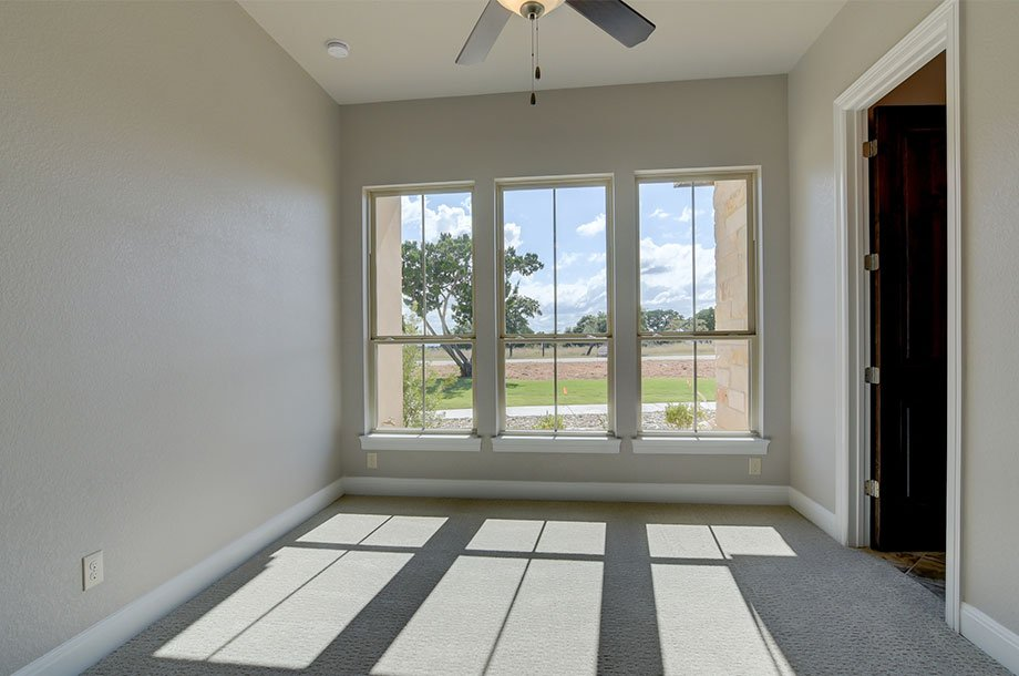 large windows overlloking front lawn of custom New Braunfels home