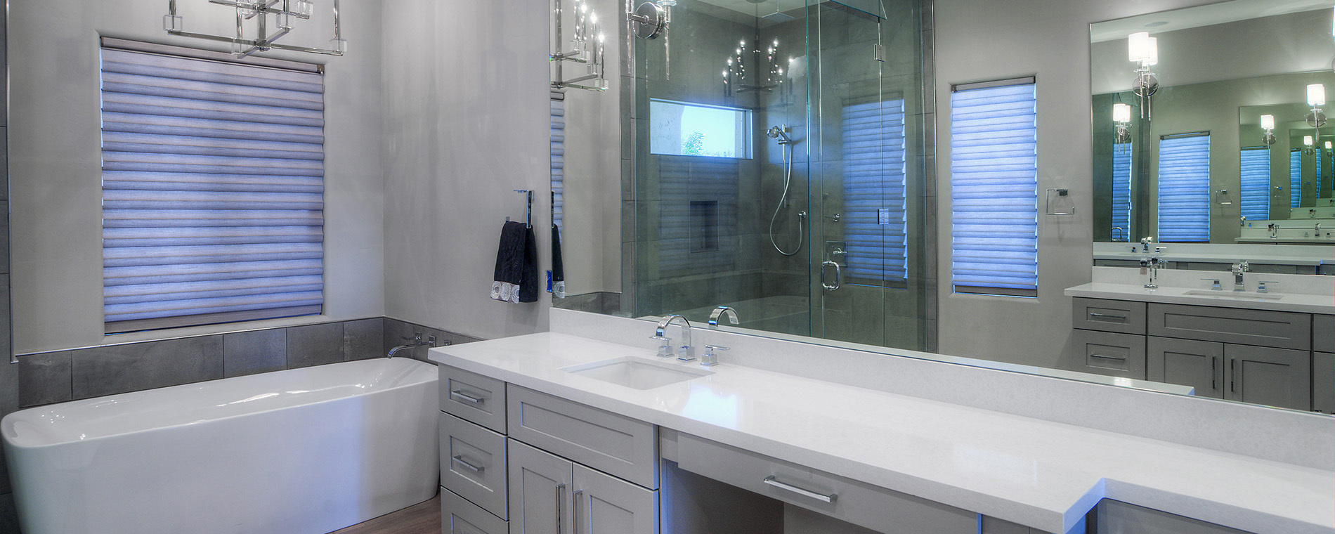 bathroom with tiled stand alone shower reflected in mirror