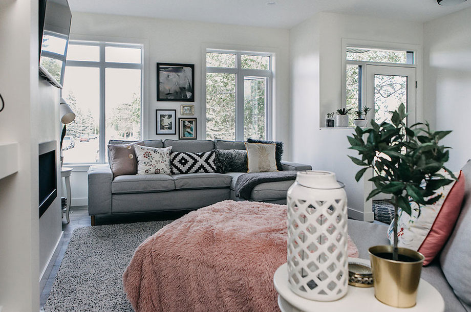 cozy living room in victoria custom home with extra blankets plants and natural lighting