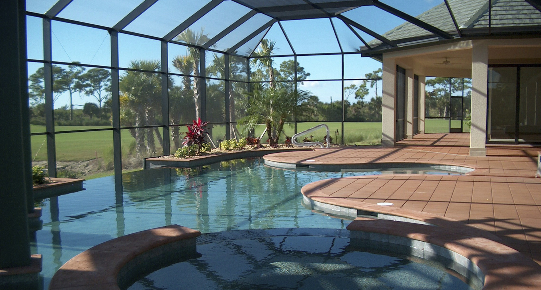 Large glass pool house addition for custom home in Bonita Springs