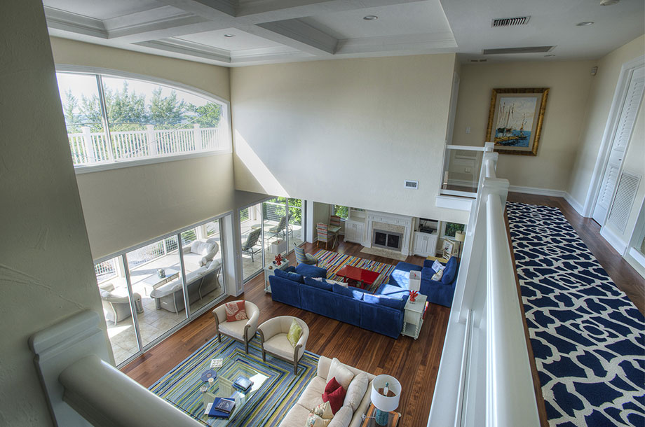 view from second story landing of bonita springs living area with vinyl flooring throughout