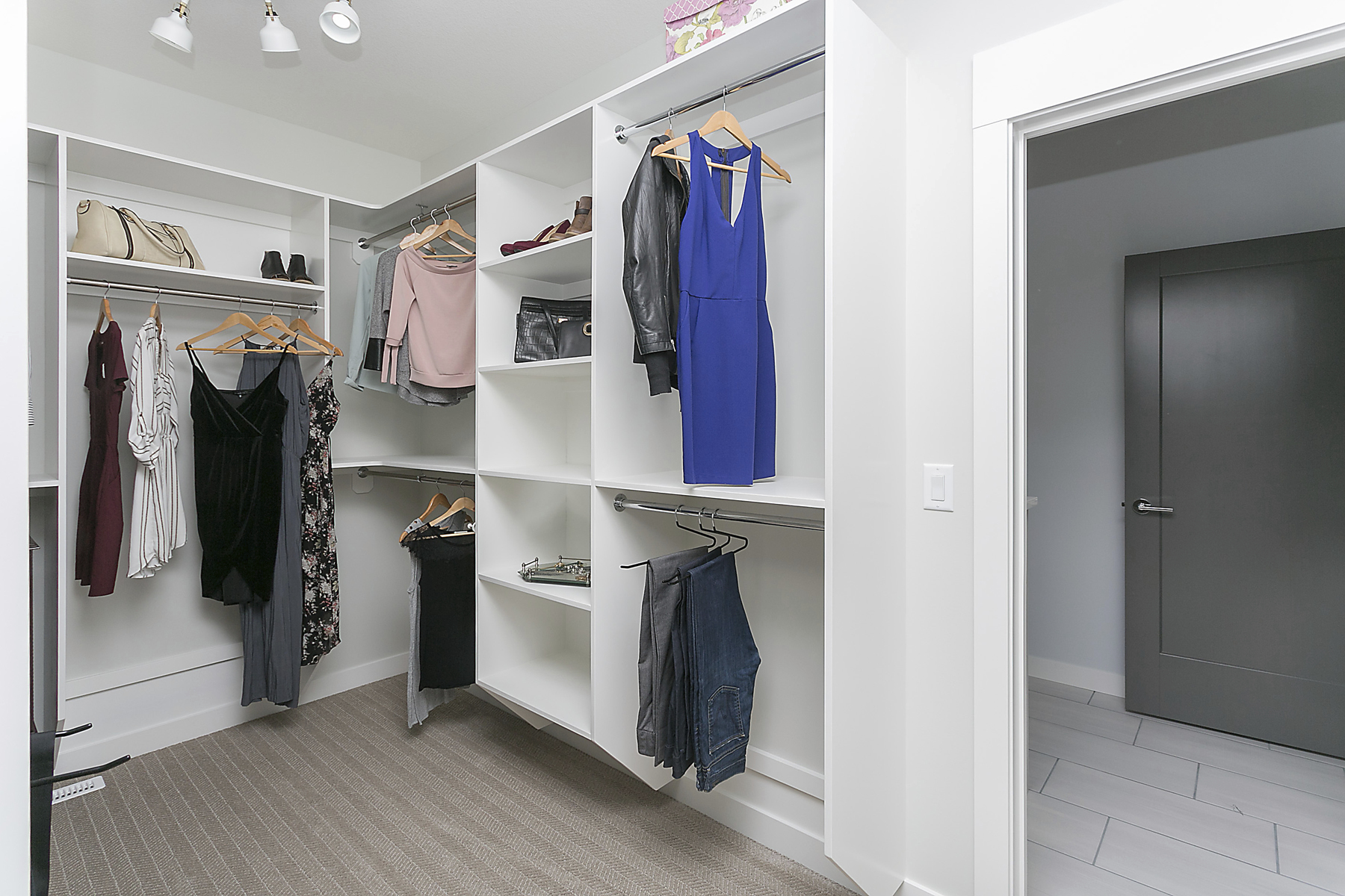 walk in closet with built in shelving units multi-level hanging rods